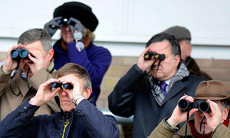 Group of people looking through binoculars